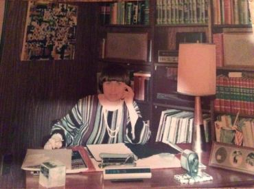 The author's mother, Adrianne, at her desk.