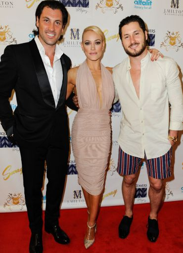 Val Chmerkovskiy (R) with his more famous brother Maks (L), who is engaged to fellow DWTS dancer Peta Murgatroyd (C).