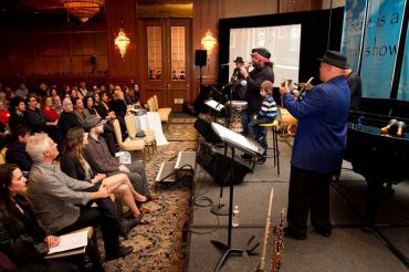 The group Moshav entertains during a Leonard Cohen Tribute