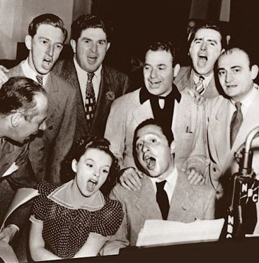 Harold Arlen and Yip Harburg sing with the cast of ?The Wizard of Oz.?