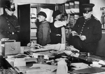 Police search German Communist headquarters, February 23, 1933.