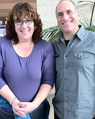 Debra Nussbaum Cohen, with singer/songwriter David Broza.