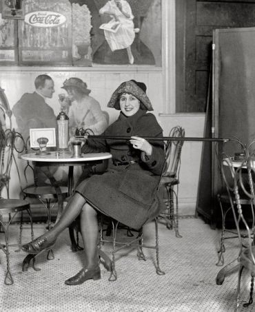 A woman uses her cane flask during prohibition.