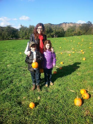 Frimet Goldberger poses with her children at a pumpkin patch.