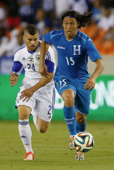 Moyal (left) playing for the Israeli national team.