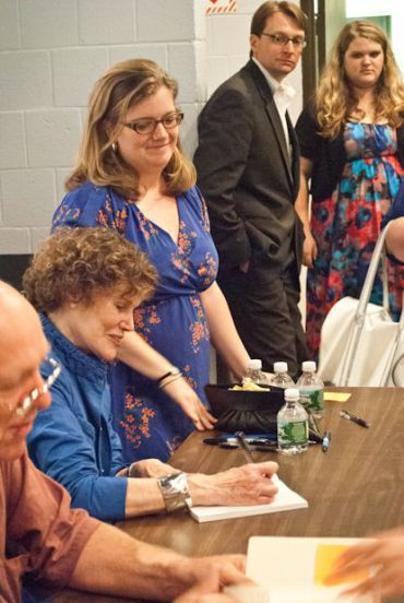 Blume signs books at a recent talk.