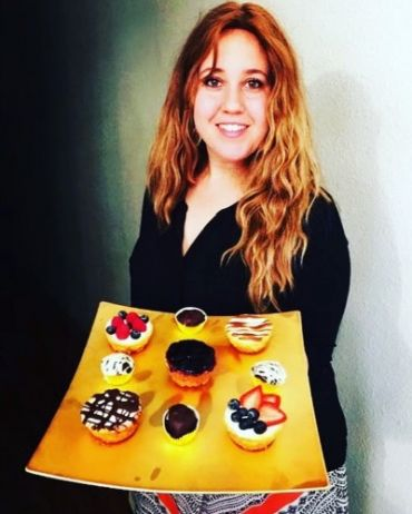 Shifra Klein poses with a selection of weed-infused treats.