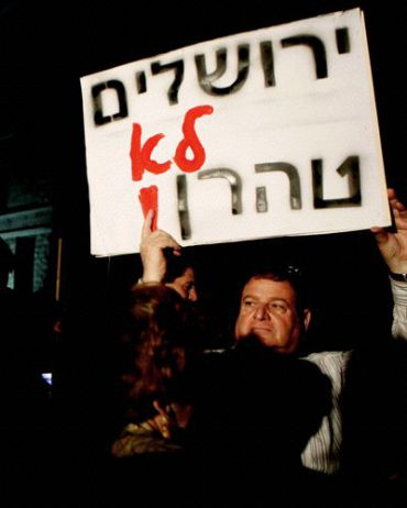 Protester in 2010 holds up sign ?Jerusalem is not Tehran.?