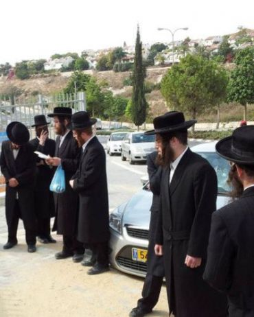 Haredi demonstrators outside Orot Banot.