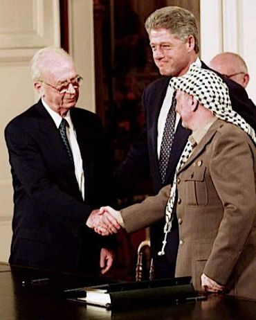 Yitzkah Rabin, Bill Clinton and Yasir Arafat in 1993