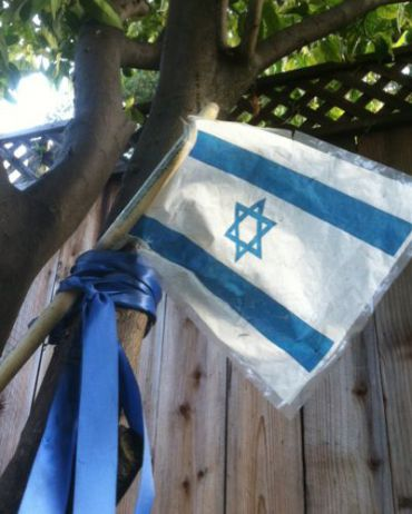 The flag honoring Gilad Shalit that hung in the author?s yard.