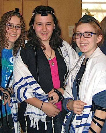 Girlchik (center) and friends in tefillin for the first time.