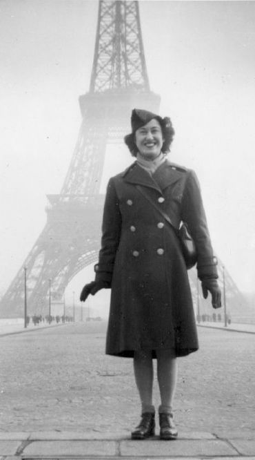 Mollie Weinstein Schaffer in front of the Eiffel Tower, Paris, France, November 1944.