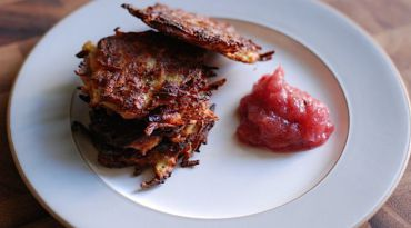 Sweet n? Tangy: Cranberries balance the sweetness in this applesauce redux served with spiced latkes.