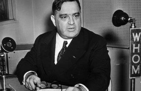 Circa 1935: New York City mayor Fiorello Henry La Guardia (1882 - 1947) sits in the studios of WHOM radio, delivering an address, in Italian, to the people of New York.