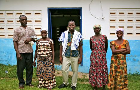 Spiritual leader Alex Armah (center) with community members at shacharit (morning) service at Tifereth Israel Synagogue, House of Israel Jewish Community. New Adiembra, Ghana. February 2014.