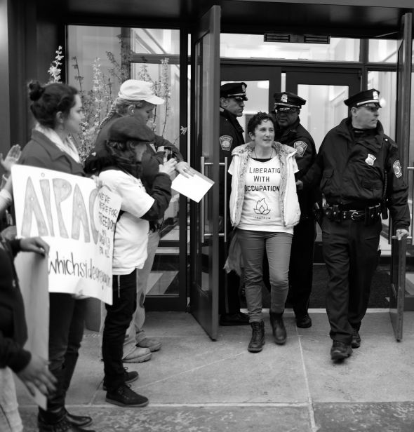 Anti-occupation protestors are arrested at AIPAC's Boston office after chaining themselves to Seder tables, as part of an initiative by the organization IfNotNow.