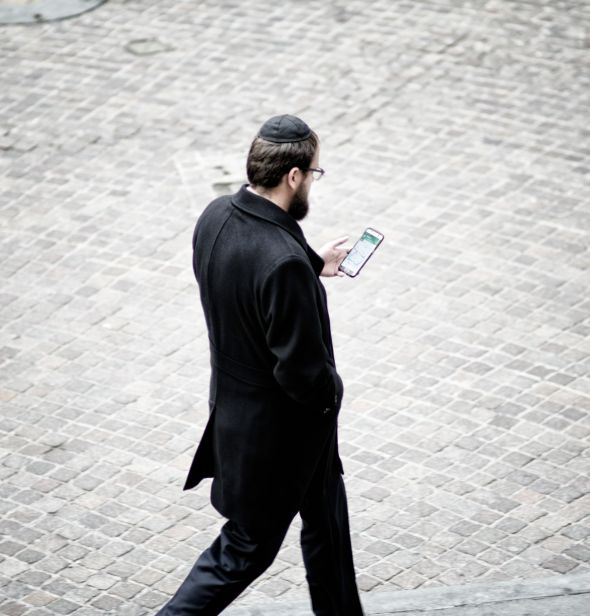 Hasidic man on Wall Street in downtown Manhattan.