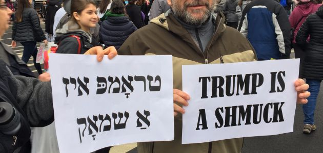 Trump is a schmuck in English and Hebrew, this protester says.