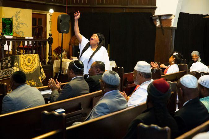 Proclaiming God: Deborah Ruben of the Beth Elohim choir rises in song during prayer.