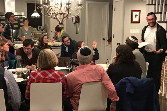 Young synagogue members gather for a lecture and dinner in Prospect Heights.