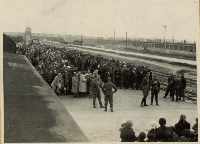 Gateway to Death: The ramp at Auschwitz II-Birkenau where SS doctors made selections for extermination among the deported Jews. An SS picture showing a new arrival of Hungarian Jews in May 1944.