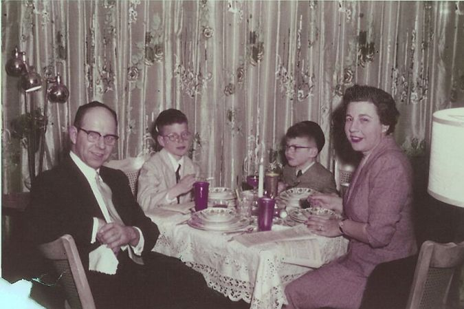 Franken, sitting next to his mother, at the the family's seder table.