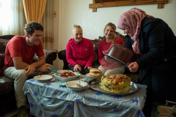Home Hospitality:Hikers on Abraham Path join a host family for lunch in Aqraba, in the Nablus area of the West Bank.