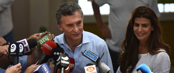 Mauricio Macri, left, joined by his wife, Juliana Awada, speaking to the media in Buenos Aires during Argentina's runoff election for president, Nov. 22, 2015.