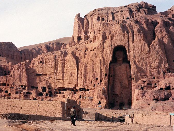 Lost Buddha: A 1997 photo shows an Afghan walking near the world's tallest standing statue of Buddha in Bamiyan province of Afghanistan.