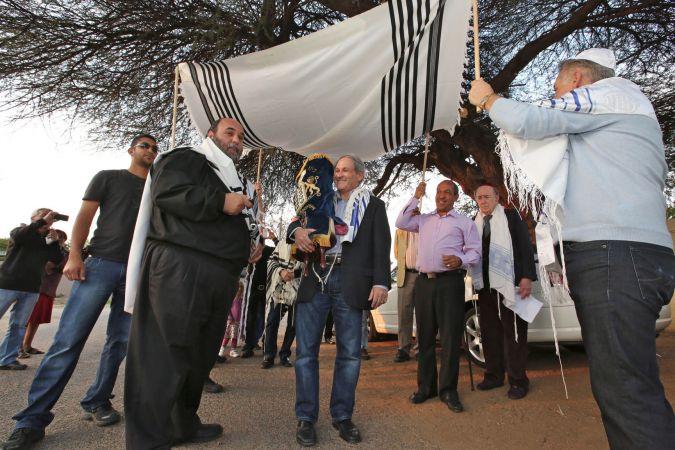 Rabbi Moshe Silberhaft (front left) presides over the first-ever Hachnasat Sefer Torah celebration in Botswana. Gaborone, Botswana. August 2013.