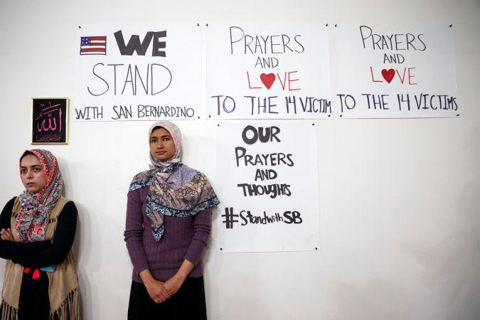 Muslim women attend memorial for victims of San Bernardino shooting spree.