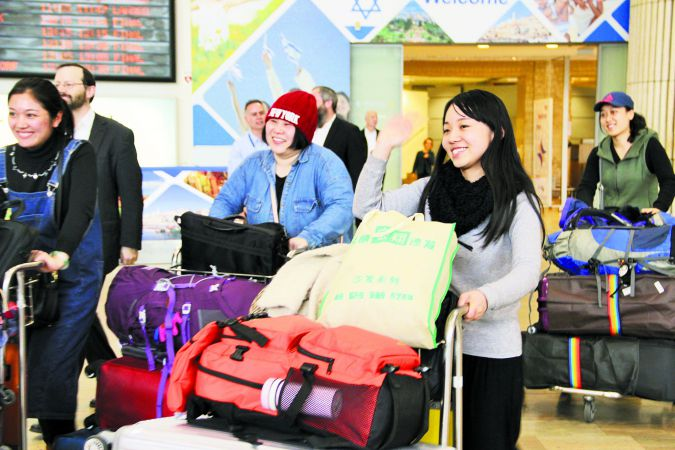 Homecoming?: Five women from Kaifeng are met at Ben Gurion airport by Shavei Israel.