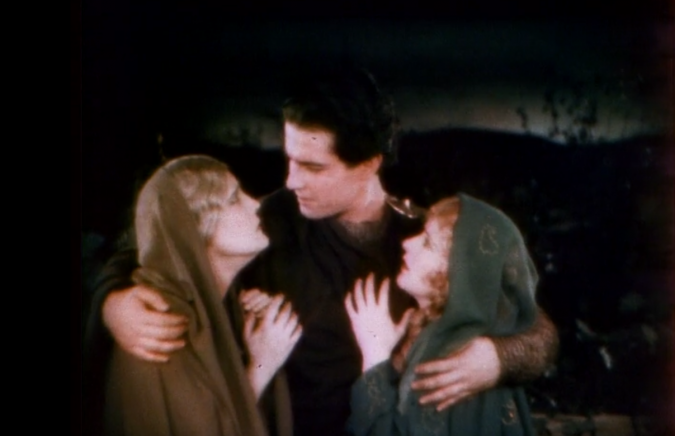 A Hint of the World To Come: Judah embraces his mother and sister, in the 1925 silent version. Although most of the movie is black and white, some scenes, especially toward the end, were color-tinted and toned, as if to suggest the beauty of the newly Christian world.