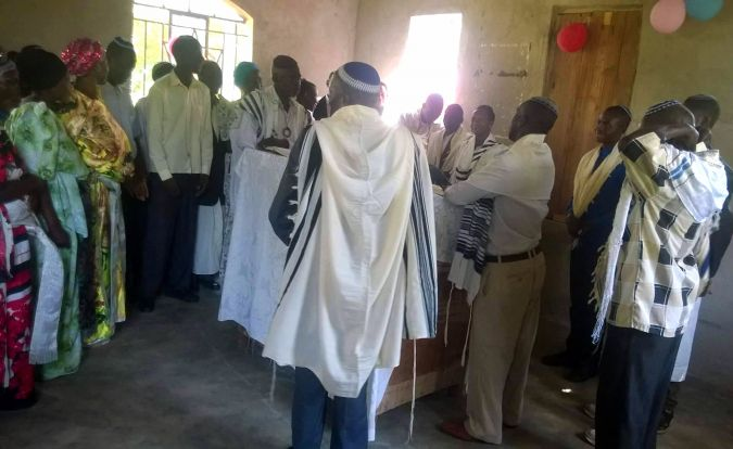 Members of the Abayudaya, the Jews of Uganda, pray in synagogue