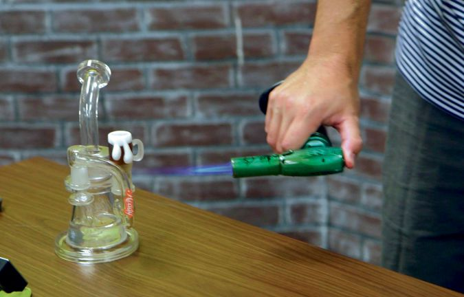 Up in Smoke: Hartfield applies a blow torch to vaporize a dab.
