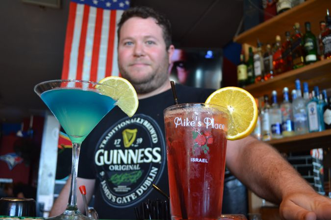Jason Jungreis, the owner of Mike's Place, poses with the election night cocktails.