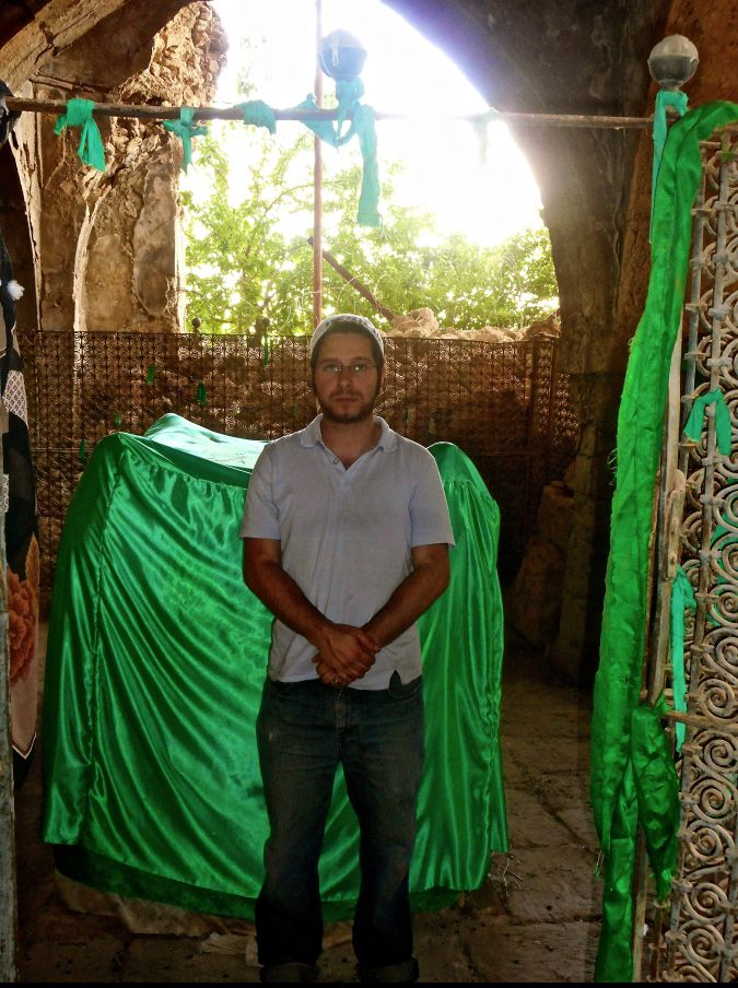 The author at the tomb of the prophet Nahum, during Shavuot.