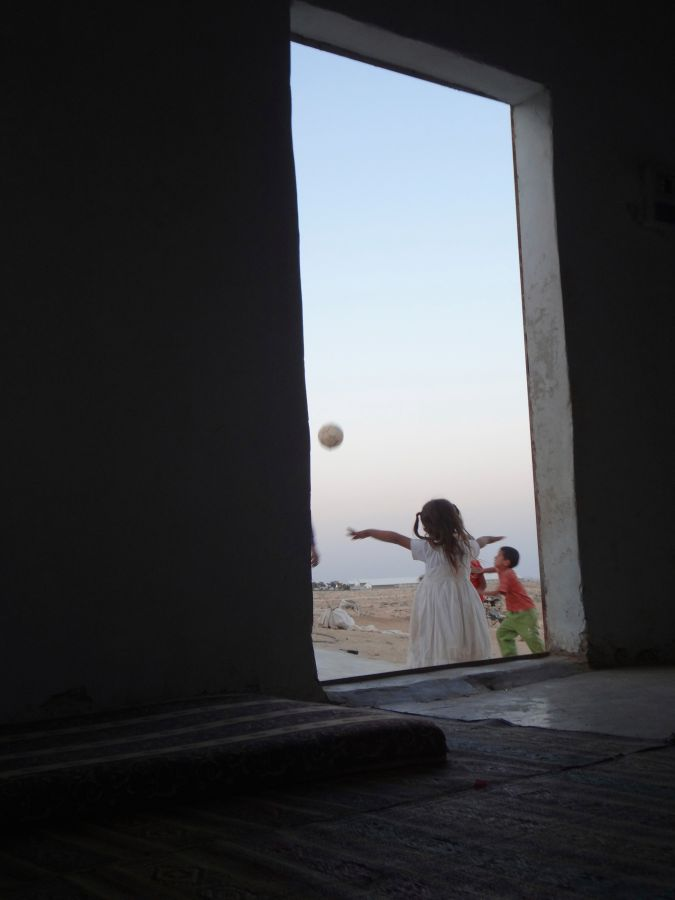 Simple Pleasures: The daughter of artist Eid Suleiman al-Hathalin playing ball on her birthday.