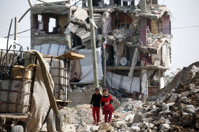 In the Rubble: Palestinian girls walk through the neighborhood of Shejaiya, largely destroyed during last summer's fighting between Israel and Hamas.