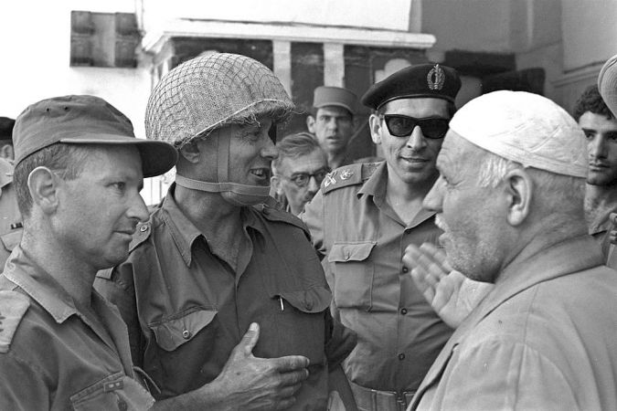 General Rehavam Zeevi (2nd R), Defense Minister Moshe Dayan (2nd L) and General Uzi Narkiss (L) meet with the Palestinian keeper of the Cave of the Patriarchs in the West Bank town of Hebron, June 8, 1967, after its capture from Jordan.
