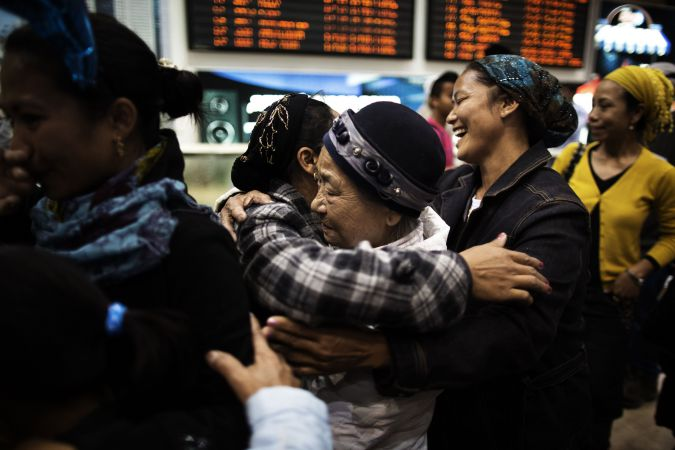 Reunion: Bnei Menashe immigrants are met by family members as they arrive at Ben Gurion airport near Tel Aviv in 2012.