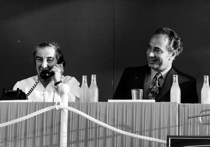 July, 1972: Shimon Peres, then a transport minister, watches as Golda Meir talks to President Nixon of the United States, using Israel's new Earth satellite communication station.