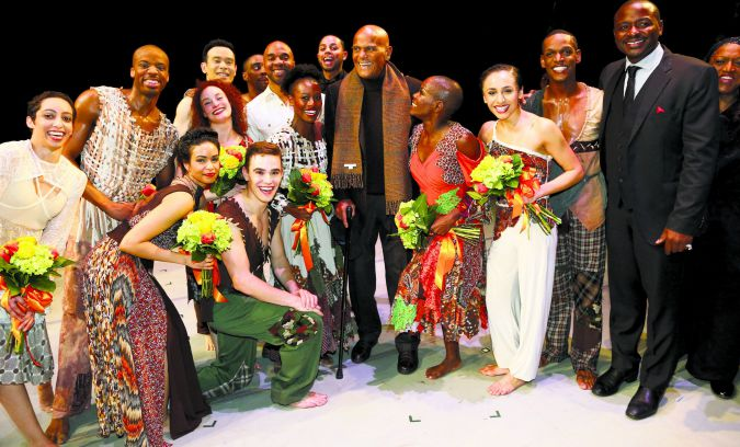 Company: Robert Battle (right, in suit) with the Alvin Ailey American Dance Theater.