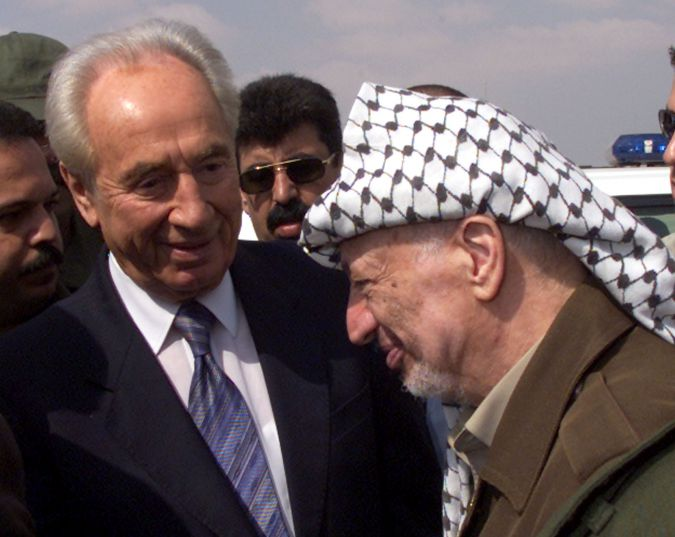September, 2001: Shimon Peres talks with Yasser Arafat at Gaza Airport in Rafah, after the two officials held talks to hammer out a lasting ceasefire aimed at ending 12 months of bloodshed.