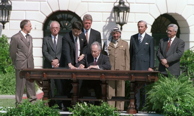 September, 1993:  Shimon Peres signs the agreement on Palestinian autonomy in the occupied territories during a ceremony at the White House in Washington, D.C.