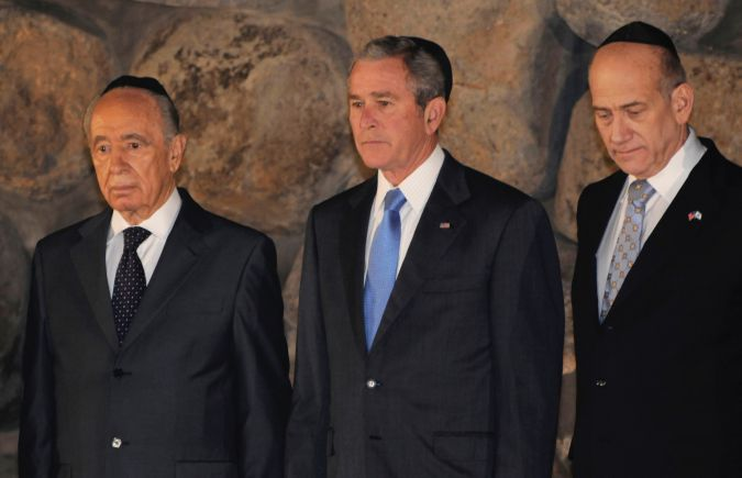 January, 2008: Shimon Peres, George W. Bush, and Ehud Olmert attend a ceremony in the Hall of Remembrance at the Yad Vashem Holocaust memorial in Jerusalem
