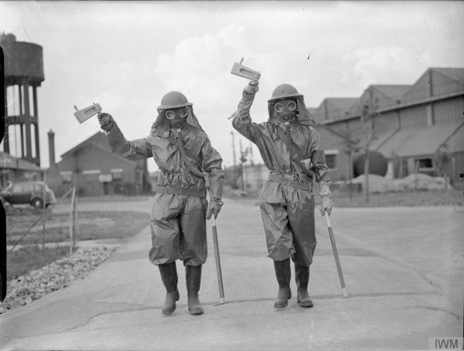 Rattle and Hum: Two airmen wield gas rattles during an exercise during World War II.