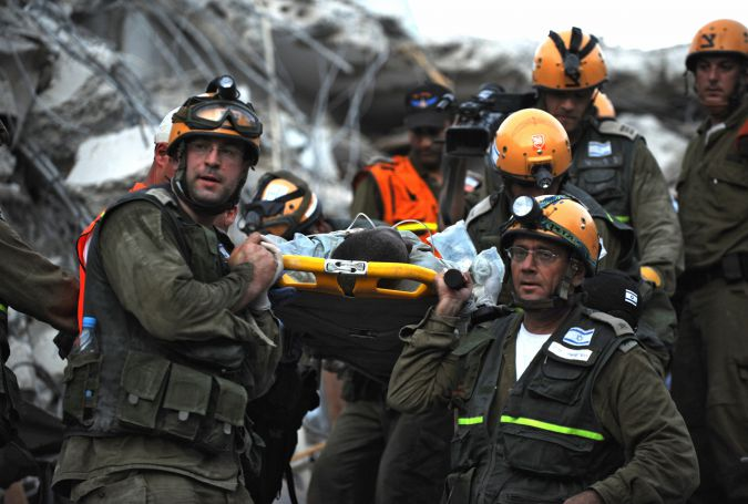 Israeli rescuers pluck victim from rubble after earthquake struck Haiti in 2010.