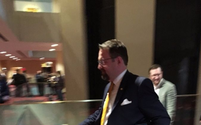 Sebastian Gorka rushes past reporters at the Jerusalem Post conference.
